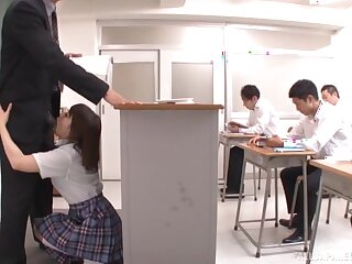 Japanese chick Otoha Nanase drops on her knees to give a blowjob
